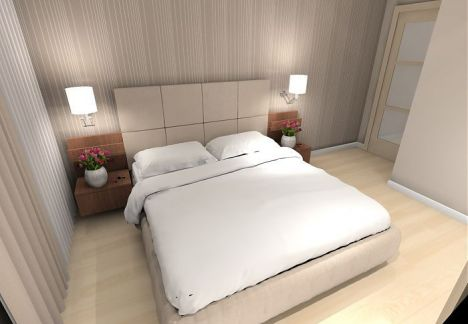 Projekt niewielkiej sypialni z tapetą o delikatnym wzorze.