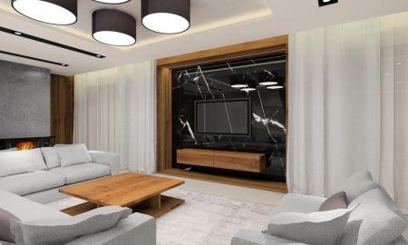 Projektowanie wnętrz salonu z kominkiem