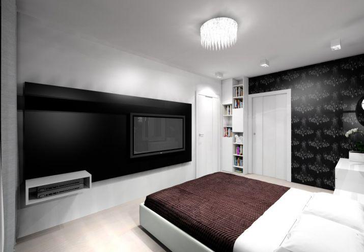 Projekt mieszkania utrzymany w jasnych barwach z dodatkiem kontrastującej czerni