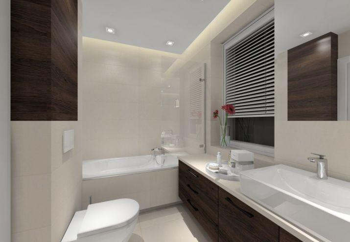 Projekt łazienki z jasnymi płytkami i ciemnym drewnem.