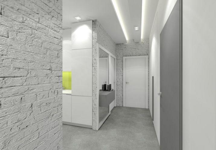 Projekt niewielkiego mieszkania utrzymanego w jasnych szarościach. Główną dekoracją jest biała cegła.