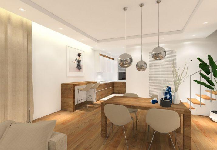Aranżacja wnętrz domu, salon z aneksem kuchennym i jadalnią.