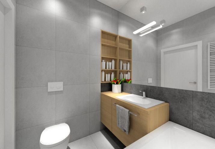 Mała łazienka z wanną.