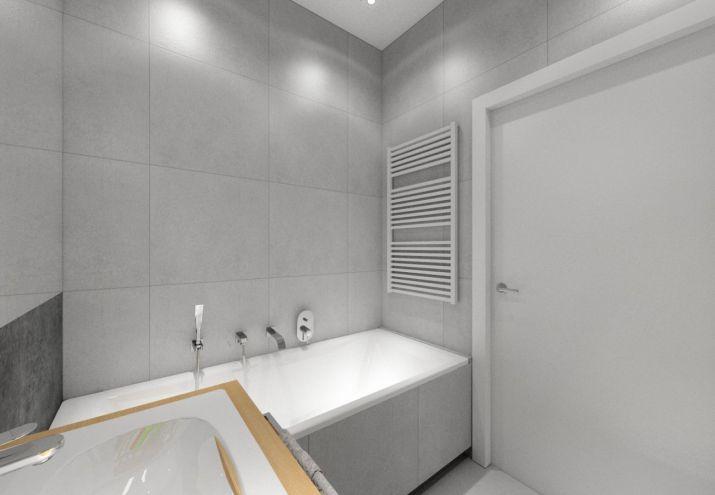Projekt szarej, prostej łazienki.